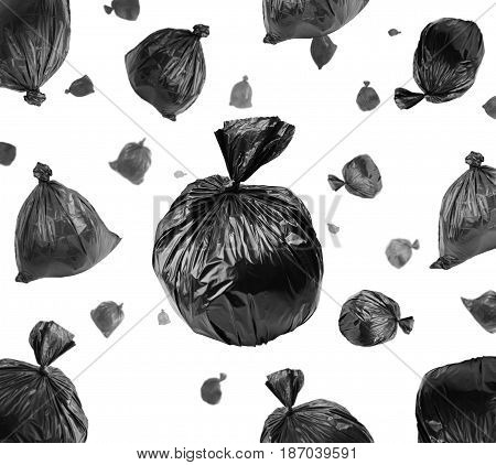 Black garbage bags isolated on white background. Environmental damage and pollution concept.