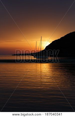 Fabulous Sunset in Cyclades islands Greece. Sailboats