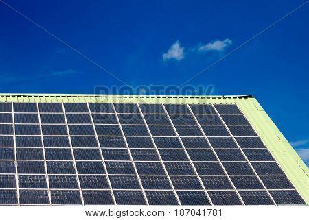 solar panel on a roof blue sky