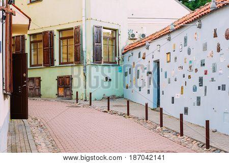 Literatu Street - one of the oldest streets in the Old Town of Vilnius, Lithuania. Wall c literary works of art. Literatu Street Wall.