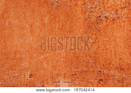 Corroded orange painted metal background. Rusty metal background with streaks of rust. Rust stains. The metal surface rusted spots. Rusty corrosion.