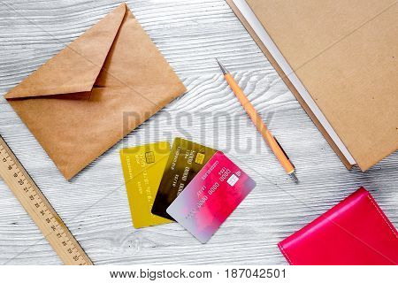 paying for studing concept with dollar sign and credit cards on light table background top view mock-up