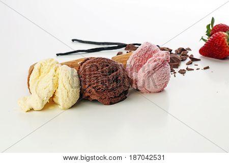 Three Scoops Of Ice Cream - Vanilla, Strawberry And Chocolate