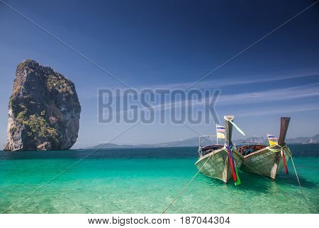 KRABI, Thailand - February 4, 2014: Traditional longtail boats on Koh Poda island, Thailand