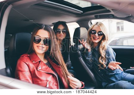 Three Beautiful Young Women Friends Have Fun In The O Car As They Go On A Road Trip