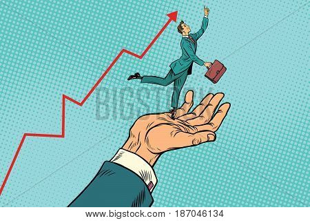 Boss and employee, a businessman on the hand high results. Pop art retro vector illustration drawing