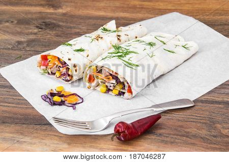 Pita bread with chicken and vegetables. Studio Photo