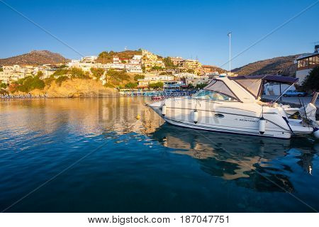Bali Island Crete Greece - June 24 2016: Beautiful morning scenery with mountains bay of Mediterranean sea and a pier with speed boat near village Bali that is located on the coast.