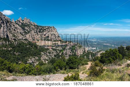 Panorama of Montserrat rocks with built monastery located near Barcelona, Spain