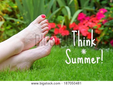 Painted toes match flowers in the garden with summer quote.