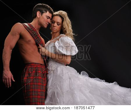 The sexy lady is hugging her highlander.