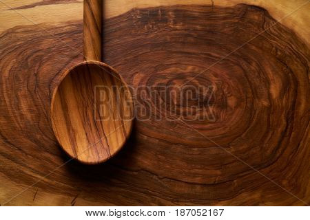 Olive wood spoon on same wooden cutting board