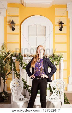 Beautiful blonde near white balustrade