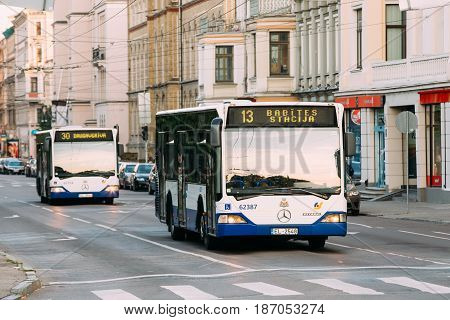 Riga, Latvia - July 2, 2016: Two Public Mercedes-Benz buses on summer Boulevard Of Freedom street in Riga, Latvia