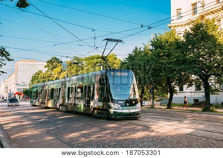 Riga, Latvia - July 2, 2016: Public Modern Tram With The Number Of The Sixth 6 Route On Summer Street Aspazijas Boulevard In Riga, Latvia