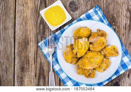 Pieces of chicken fillet, fried in corn breadcrumbs. Studio Photo