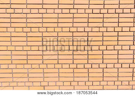 A Wall Of Cracked Bricks With Fresh Cement Joints