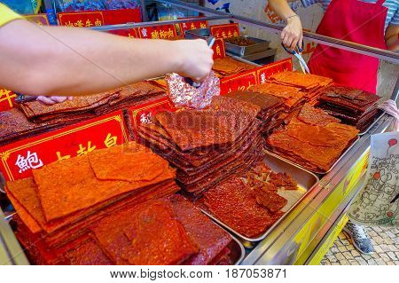 MACAU, CHINA- MAY 11, 2017: Delicious chinese food dried meat slice