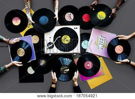 People Hands Holding Vinyl Records