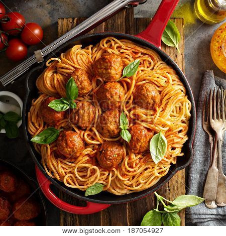 Spaghetti with tomato sauce and meatballs, fresh vegetable salad and red wine overhead shot