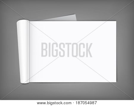 Blank open magazine with rolled page on neutral grey background . Horizontal orientation. Template for your design.