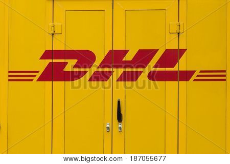 BErlin Germany - may 16 2017: DHL logo on delivery truck car door. DHL is the global market leader in logistics industry.