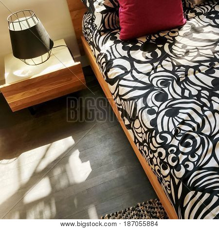 Bright cozy bedroom in sunlight. Stylish home decor.