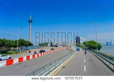 MACAU, CHINA- MAY 11, 2017: Famous roadtrip with Macau Tower behind, urban ladscape near river in macao asia.