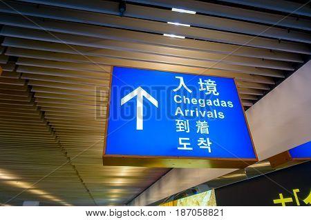 MACAU, CHINA- MAY 11, 2017: Macau arrival sign post travel immigration in the airport of Macau China.