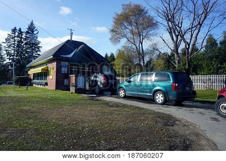 BAY VIEW, MICHIGAN / UNITED STATES - NOVEMBER 26, 2016: Vehicles line up for a car wash at the Bay View E-Z Mart, which offers a discounted wash on Tuesdays.
