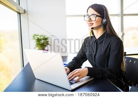 Businesswoman With Headset In Call Center In Office