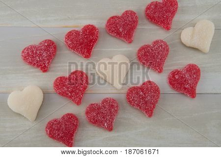 Angled View of Red and White Gummy Hearts Lined Up