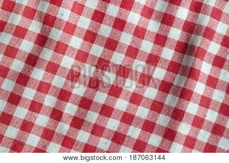 Red vintage picnic tablecloth. Texture of a red and white checkered picnic blanket.
