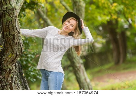 lifestyle outdoor portrait of young beautiful woman on natural background