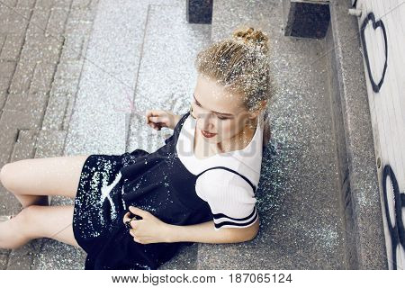 young pretty party girl smiling covered with glitter tinsel, fashion dress, stylish make up, lifestyle real people concept close up