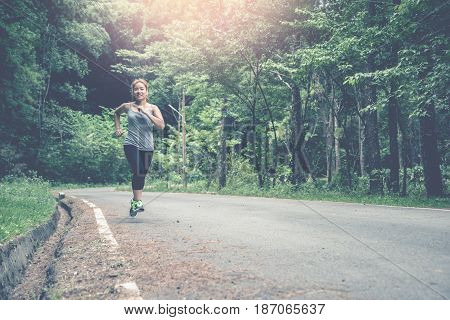 Women jogging On the nature trail in the park