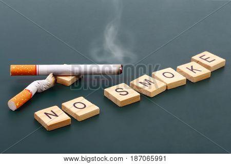 World No Tobacco Day No smoke wording with cigarette on dark background.