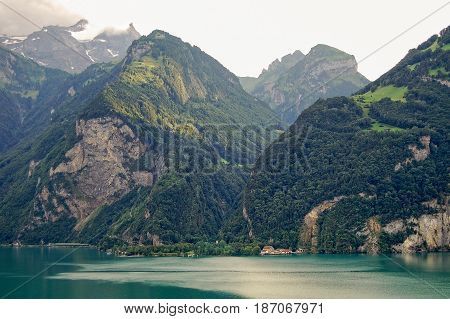 The emerald water of Lake Uri (Urnersee) one of the four basins of Lake Lucerne and the surrounding mountains - Fluelen Switzerland
