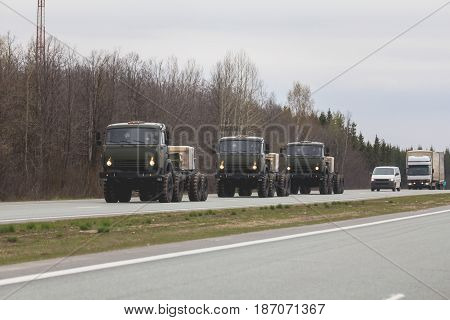 Three military truck on the road - Russian army, telephoto