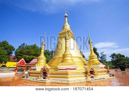Golden pagoda at Wat Varee Banpot Wat Bang NonRanong ProvinceAncient Thai temple golden pagoda the beautiful Burmese and thai respect of everyone.