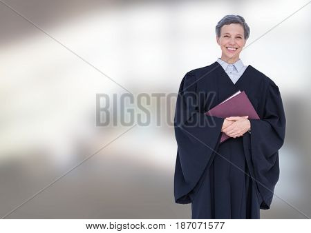 Digital composite of Judge holding book in front of bright background