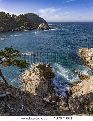 Crystal blue ocean views of the rough waters and textured rocks
