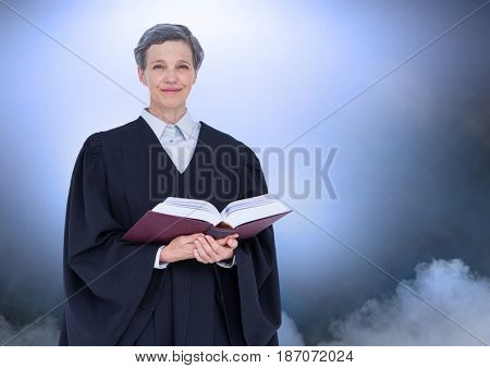 Digital composite of Judge holding book in front of clouds and light