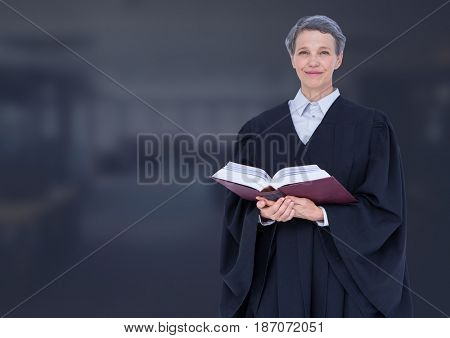 Digital composite of Judge holding book in front of dark office background