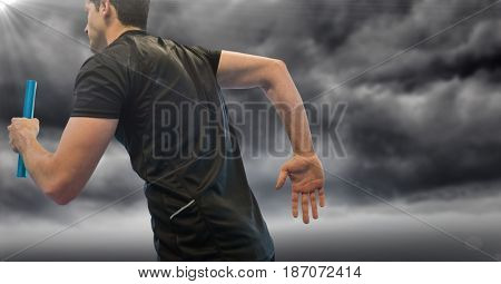Digital composite of Relay runner and flare against stormy sky