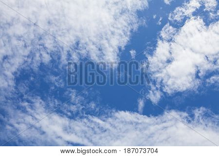 Blue sky background with white clouds and rain clouds. The vast blue sky and clouds sky on sunny day.