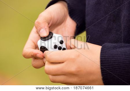 Quito, Ecuador - February 10, 2017: Fidget Cube stress reliever Fingers Toy