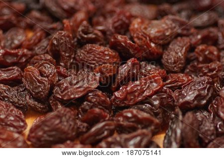 Delicious raisins as background Grape Raisin texture.