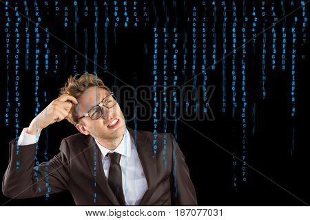 Digital composite of Digitally generated image of confused businessman looking at various blue letters