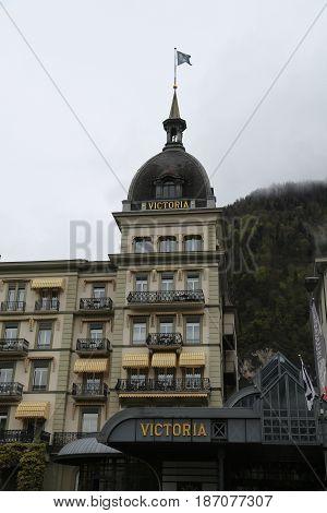 INTERLAKEN, SWITZERLAND - MAY 8, 2017: Historic Victoria Jungfrau Grand Hotel and Spa in Interlaken, Switzerland.